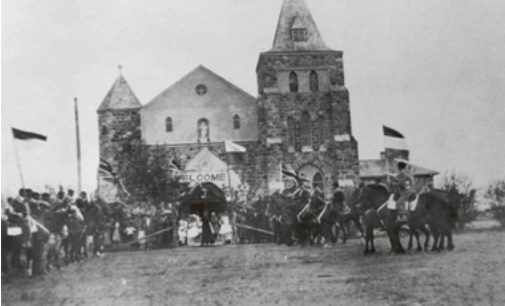 photo of Hungarian mounted honour guard at stone church, 1936 jubilee ceremony